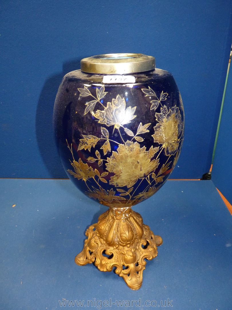 A large blue glass bowl etched with metal leaf pattern to exterior (converted from an oil lamp to a
