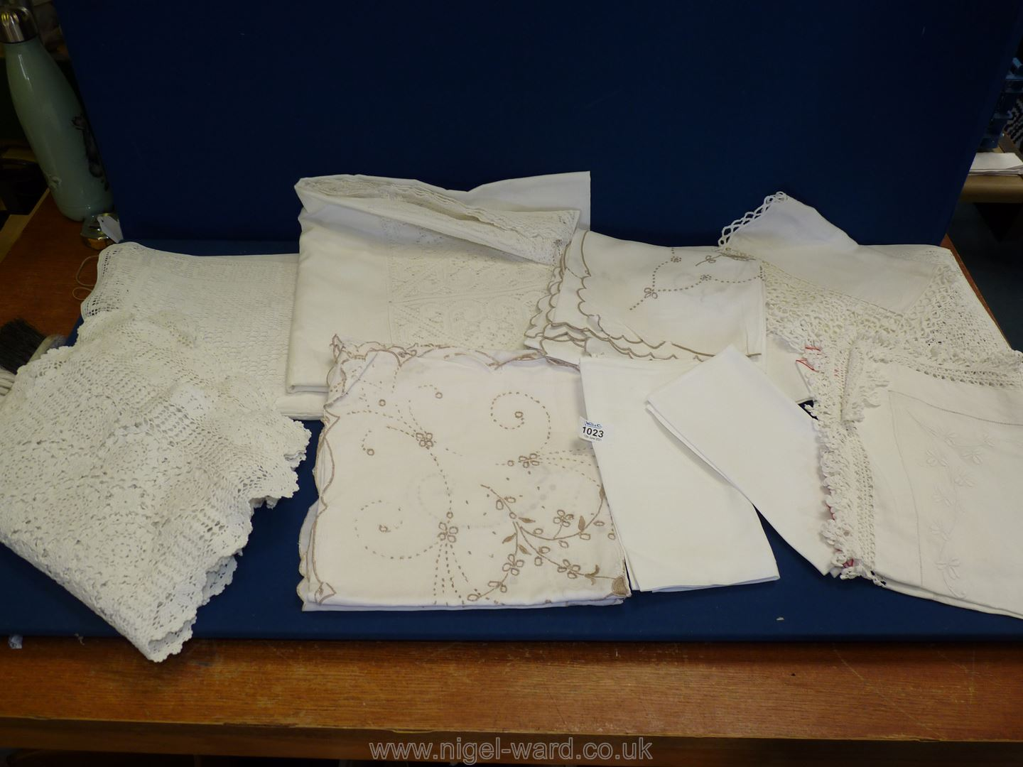 A box of antique/vintage lace and linen items.