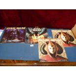 Four large Star Wars calendars.