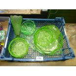 An Art Deco green Uranium glass dressing table set, green glass fruit set and vase.