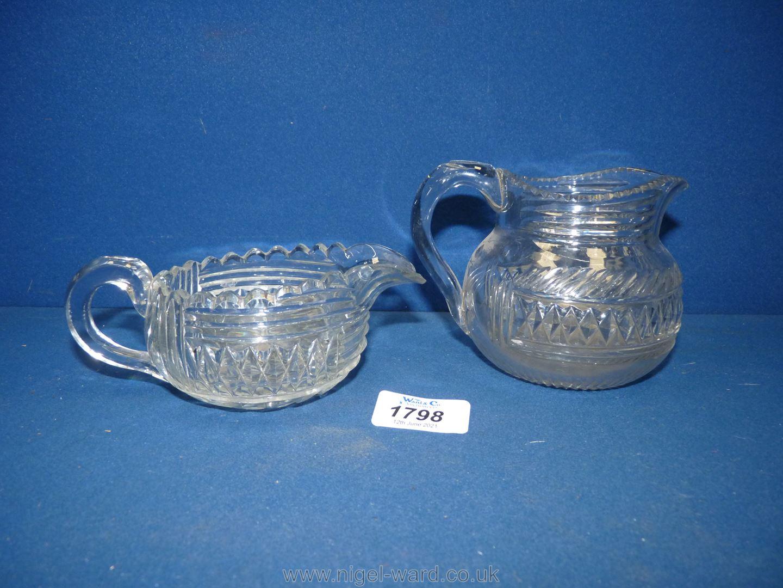 Two Regency cut glass cream jugs.