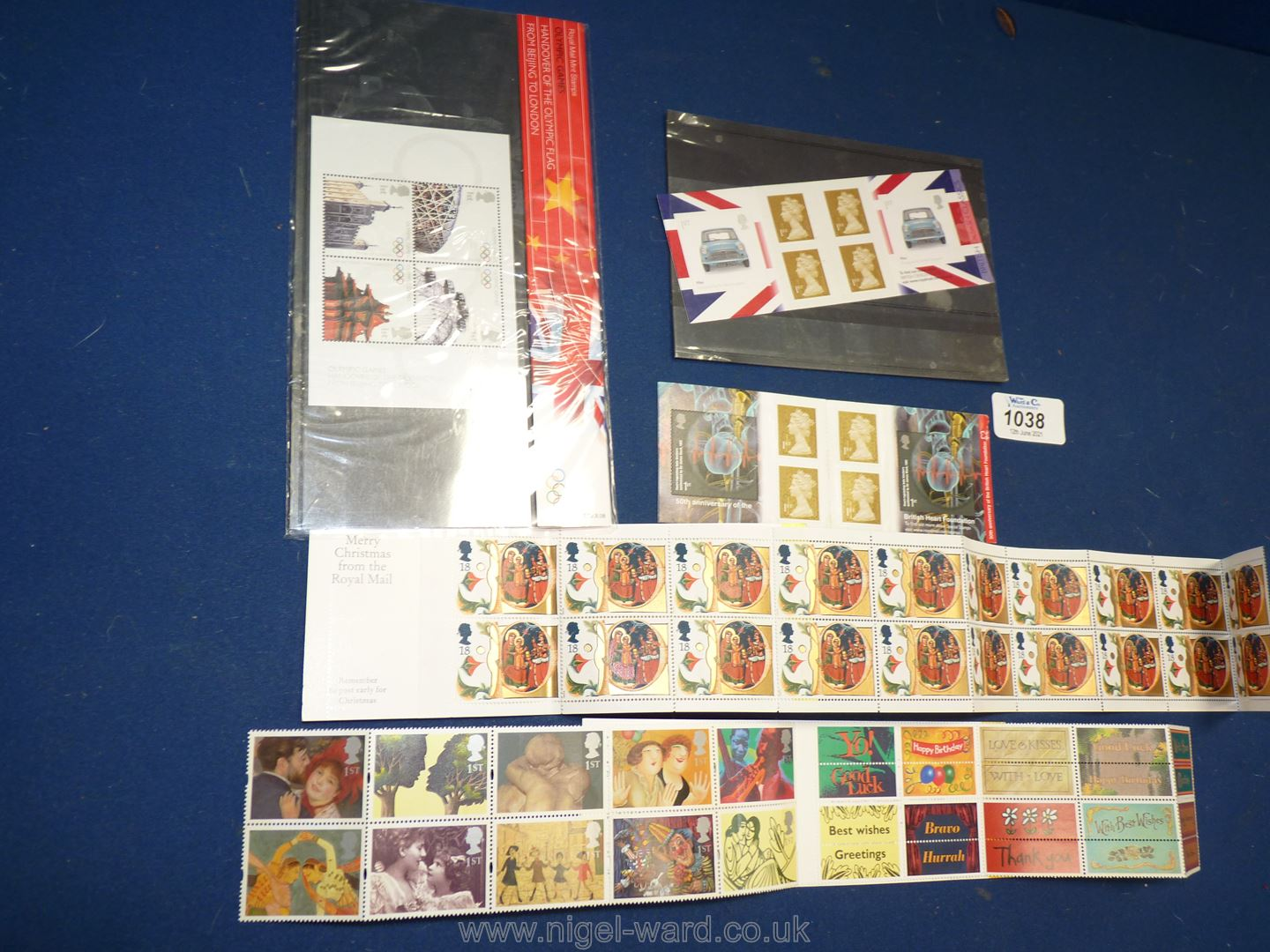 Four complete Stamp books and an Olympic presentation pack.