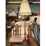 A polished turned Mahogany Standard Lamp having a lined beige pleated shade.