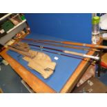 A 9' two section fly rod plus a 12' three section cane rod, (a/f) both un-named.