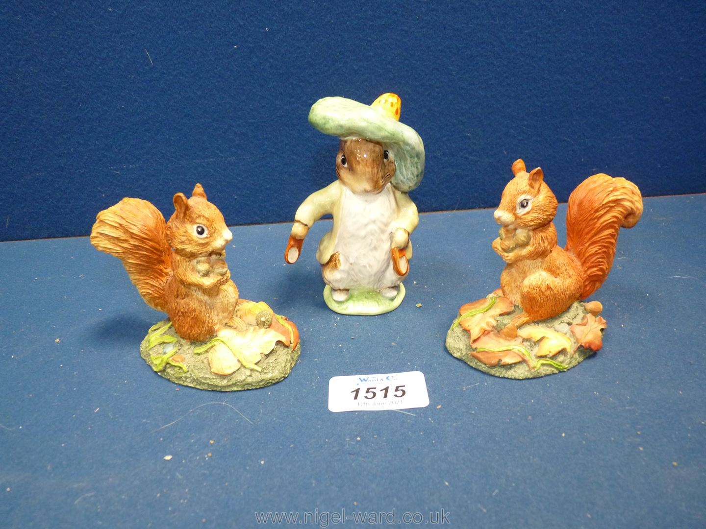 A Beswick 'Benjamin Bunny', (ear chipped) and two Beswick Red squirrels.