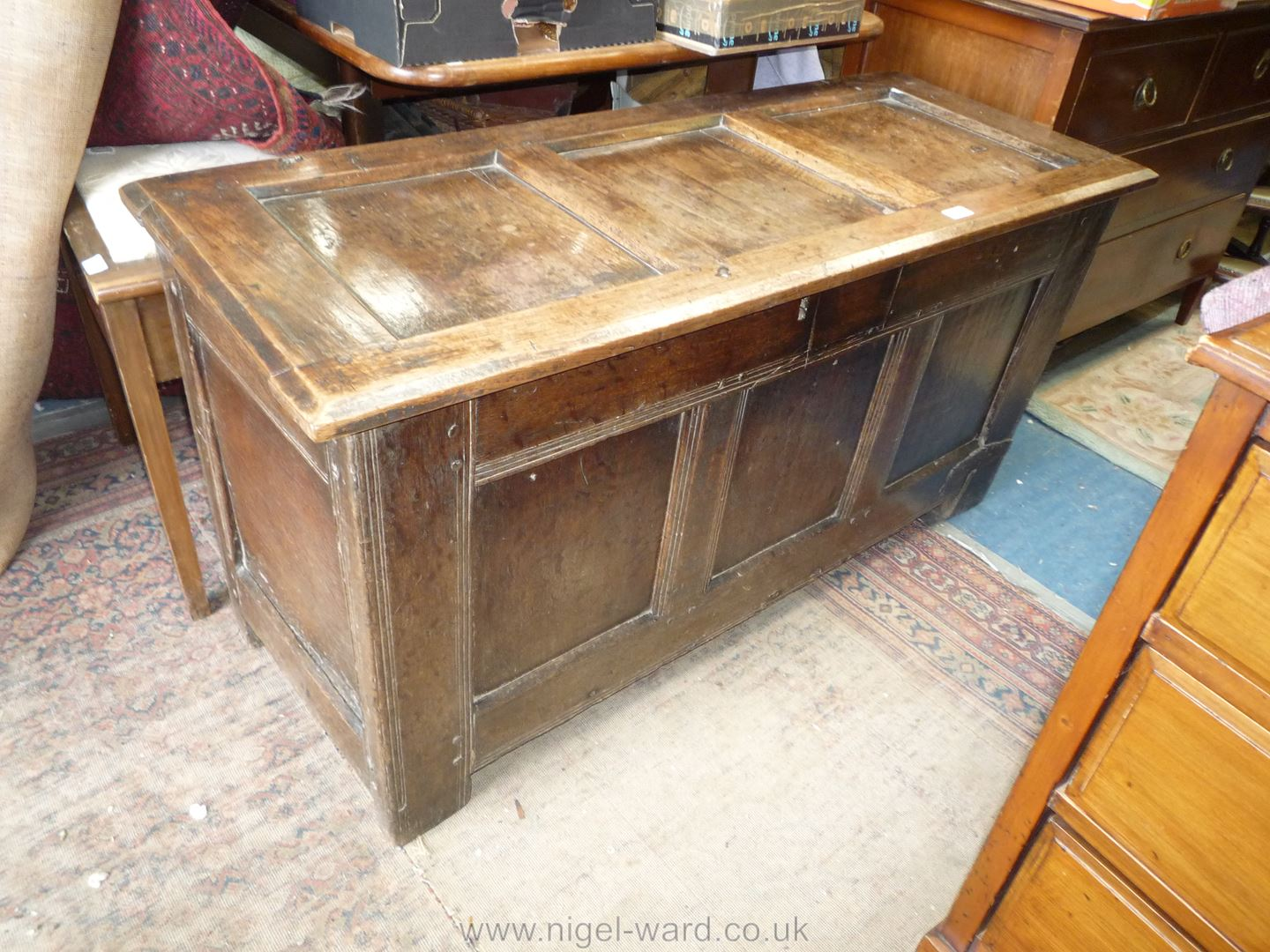 A delightfully plain peg-joined Oak three panel Coffer with scratch-moulded details and old metal