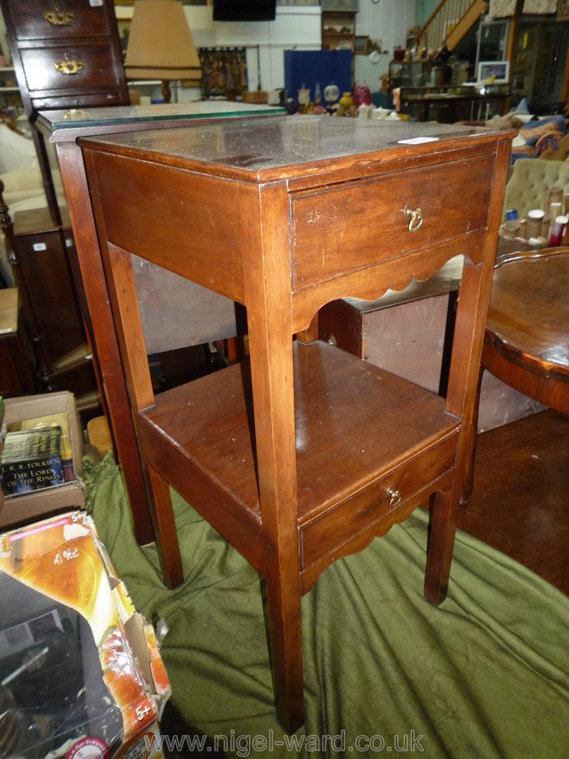 A Mahogany campaign Bedside Table of traditional Georgian design having a frieze drawer and a lower