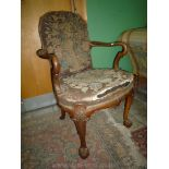 A fine antique Walnut armchair, the frame with carving of the highest quality throughout,