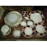 A part Teaset in navy and gold pattern and a quantity of miscellaneous plates