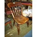 An antique solid Elm seated kitchen Chair having turned details to the back and to the legs and