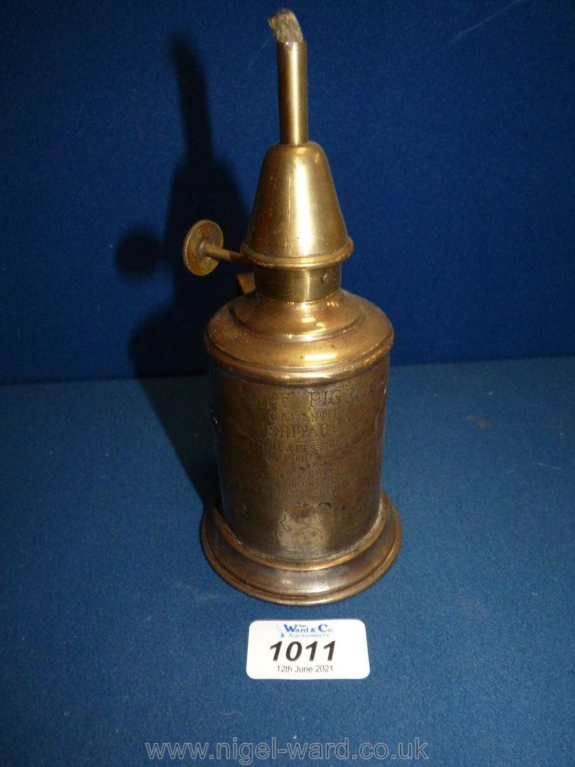 "A small brass pigeon lamp, 7"" tall."