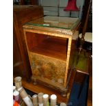 A Mahogany and Walnut bedside Cabinet standing on brief cabriole legs and having an open shelf with