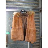 A Jacques Saint Laurent fur jacket with front zip and hood, size medium.