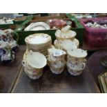 A pretty twelve setting Teaset, with cream rim and pink flowers by The Regent China Co.