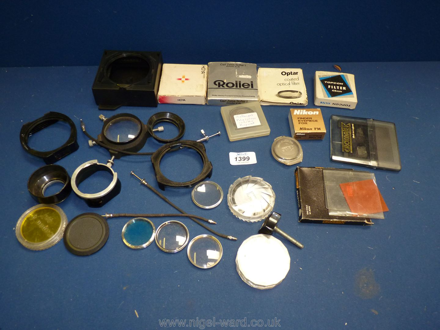 A quantity of camera filters including Rolleipol, Polarscreen, Zeiss Softer I, Cenei Plan 40.