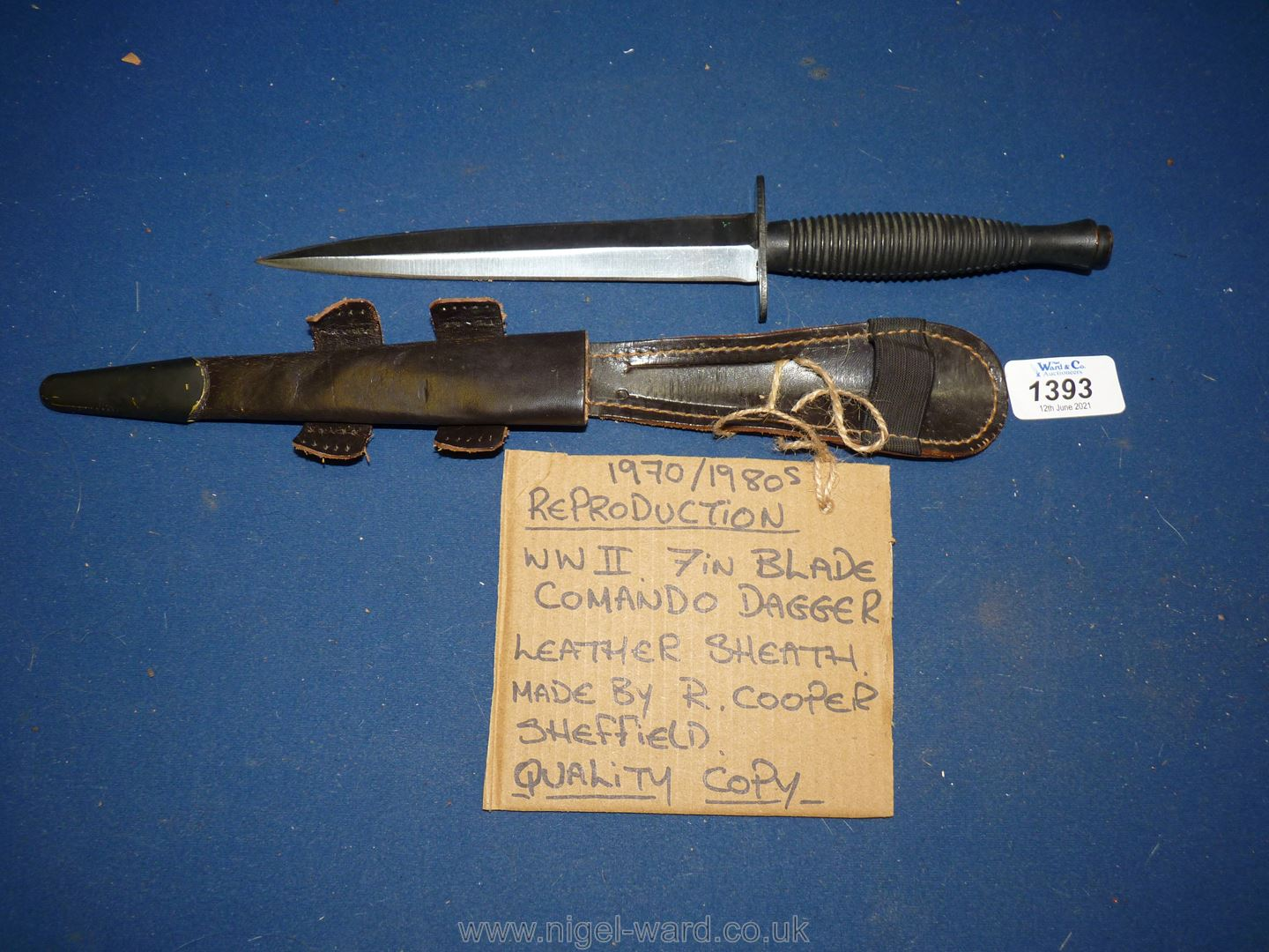 A reproduction copy of WWII commando Dagger, 7'' blade with leather sheath made by R.
