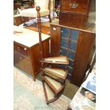A Mahogany framed four step Library or bed Steps having padded treads,