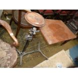A cast iron and Oak finished ''Reading Machine/The Studying Table'',