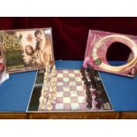 Lord of The Rings: a boxed chess set and Two Towers board game.