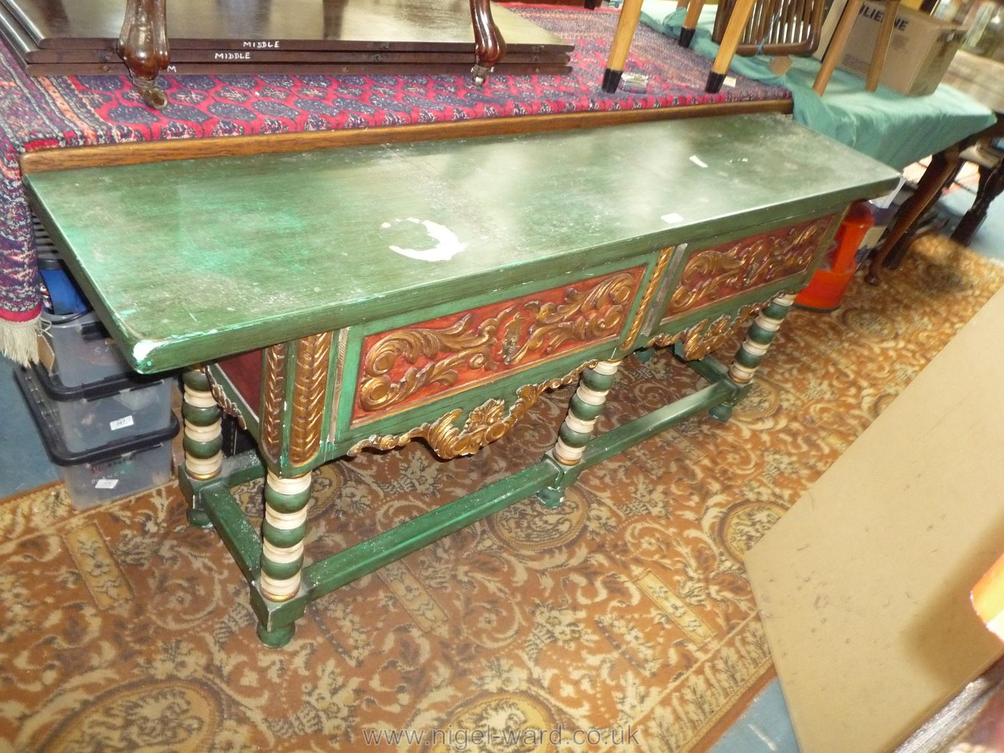 A carved and painted Continental dresser Base standing on turned legs with perimeter stretchers and