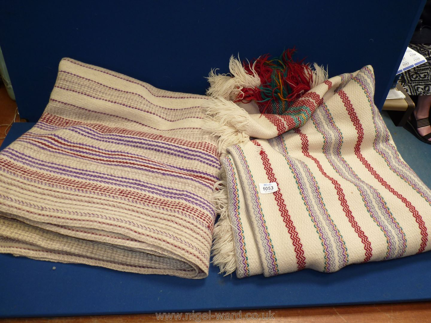 Two single Welsh Blankets, one with fringing in cream.