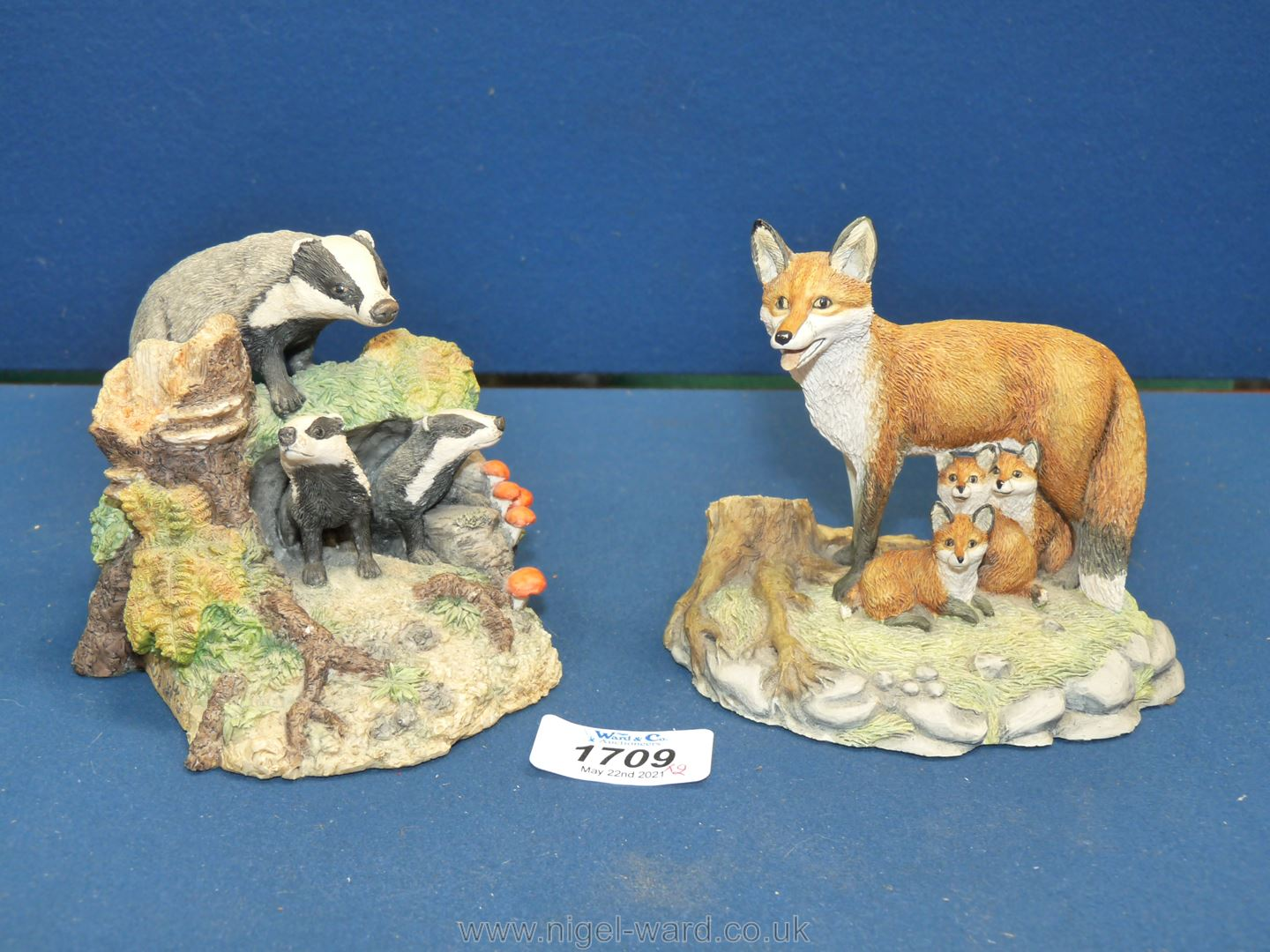 Two Border Fine Arts figures - badger family and fox family.