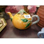 A decorative vintage Portuguese teapot in the form of an orange,
