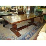 A most substantial five plank topped Baronial style Oak Refectory Dining Table having cleated ends