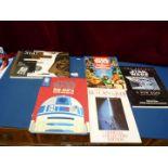 Five large Star Wars books.