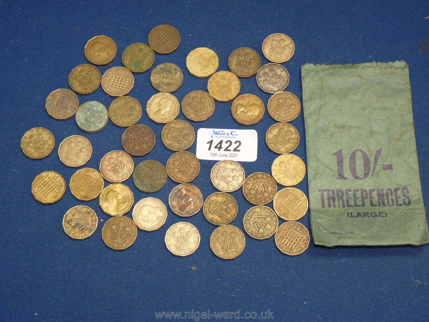 A quantity of pre decimal coins including 10/6- in threepenny bits,