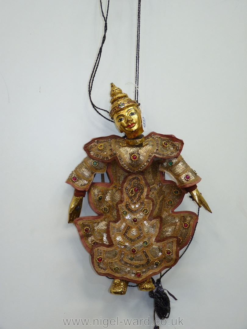 An ornate Thai Marionette richly decorated with sequins, 16 1/2'' tall approx.