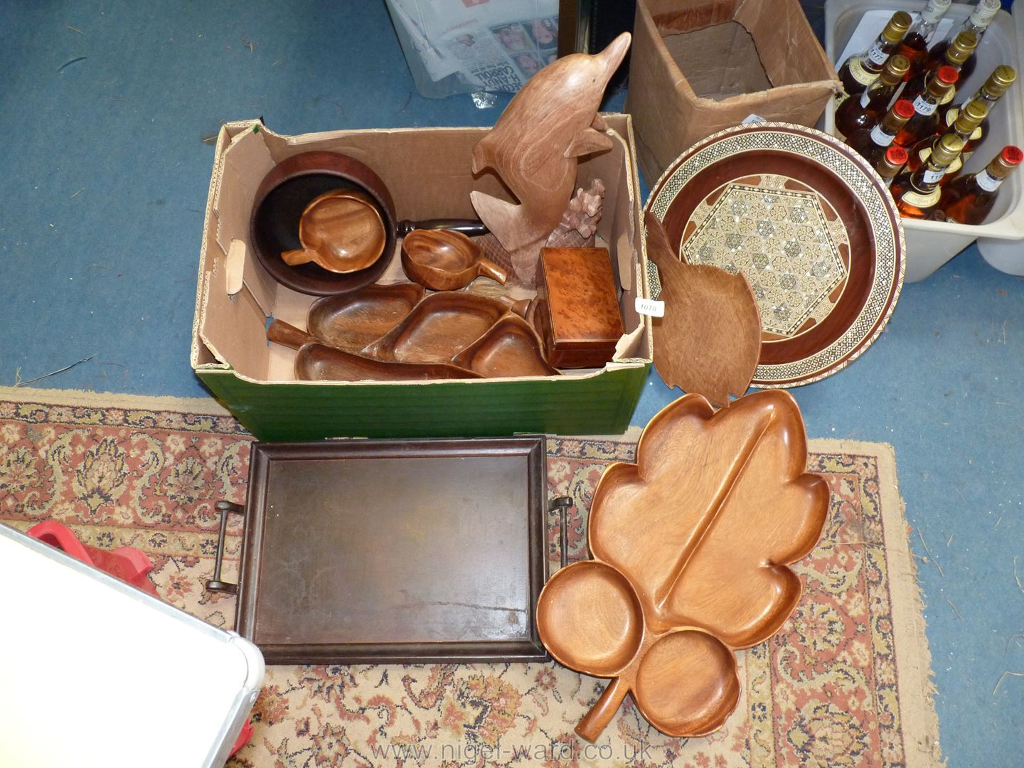 A quantity of treen including large dolphin, large leaf platter, mother of pearl decorated charger,