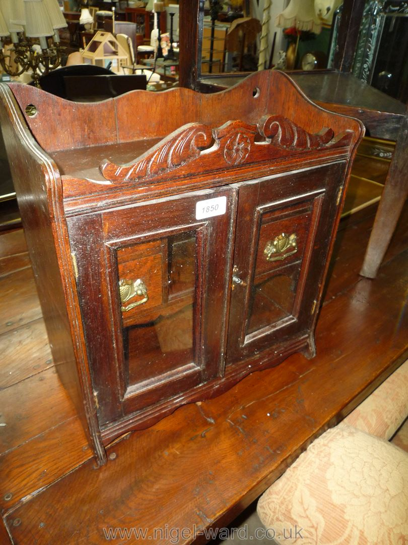A most appealing Oak table top or wall-hanging Cabinet,