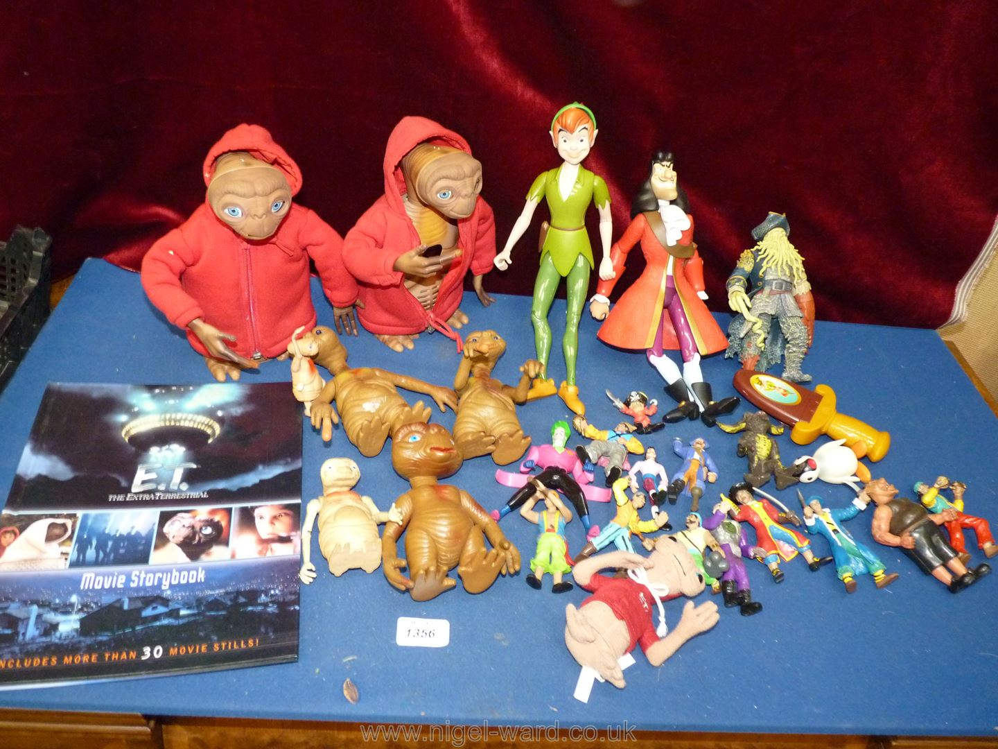 A box of characters from animated films including ET, Peter Pan and Captain Hook (x2).