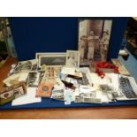 A quantity of miscellanea including photographs, first day covers, loose stamps, cloth badges,