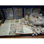 A quantity of stock books filled with English and foreign stamps and a large quantity of loose