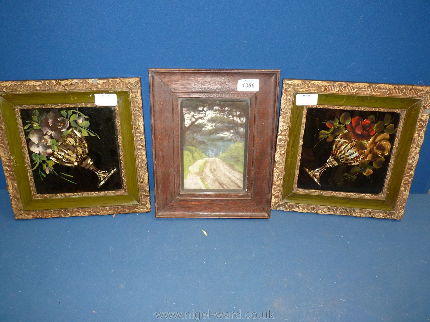 Two highly decorated picture frames having painting on glass pictures together with a Watercolour