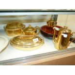 A quantity of Royal Worcester gold lustreware including tea,