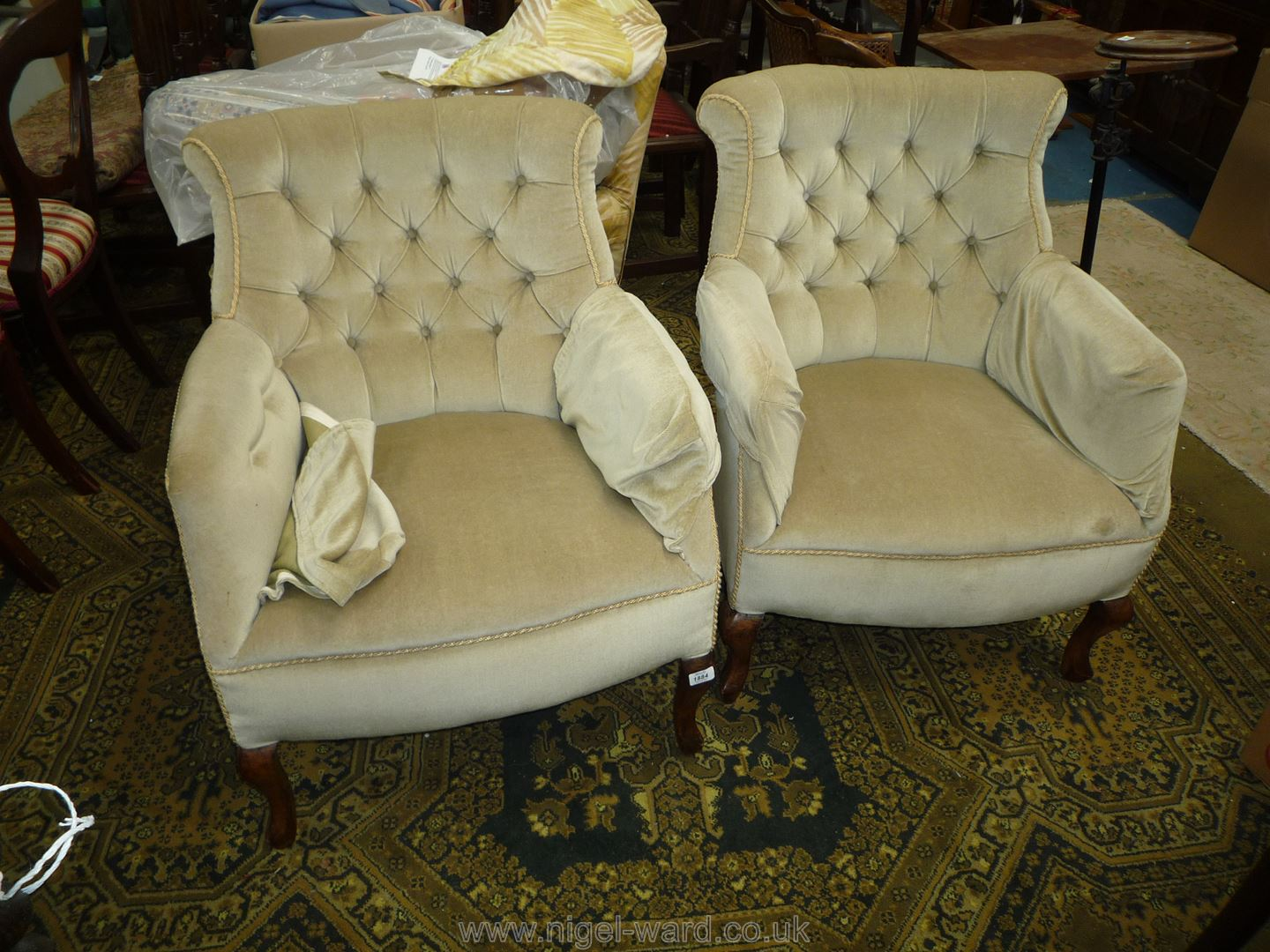 An elegant pair of pre-1950 button-backed Armchairs upholstered in delicate pale fern green draylon,