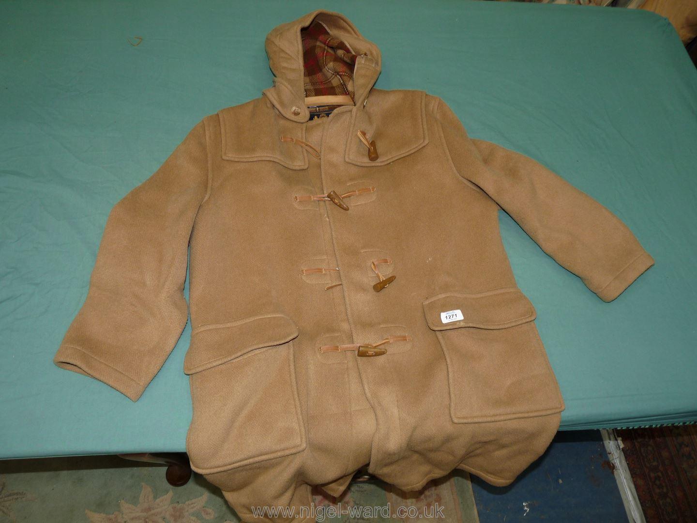 An origiinal camel duffle coat by Gloverall.