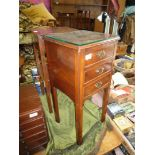 A Bedside night Stand having three short drawers and standing on square legs with moulded corner