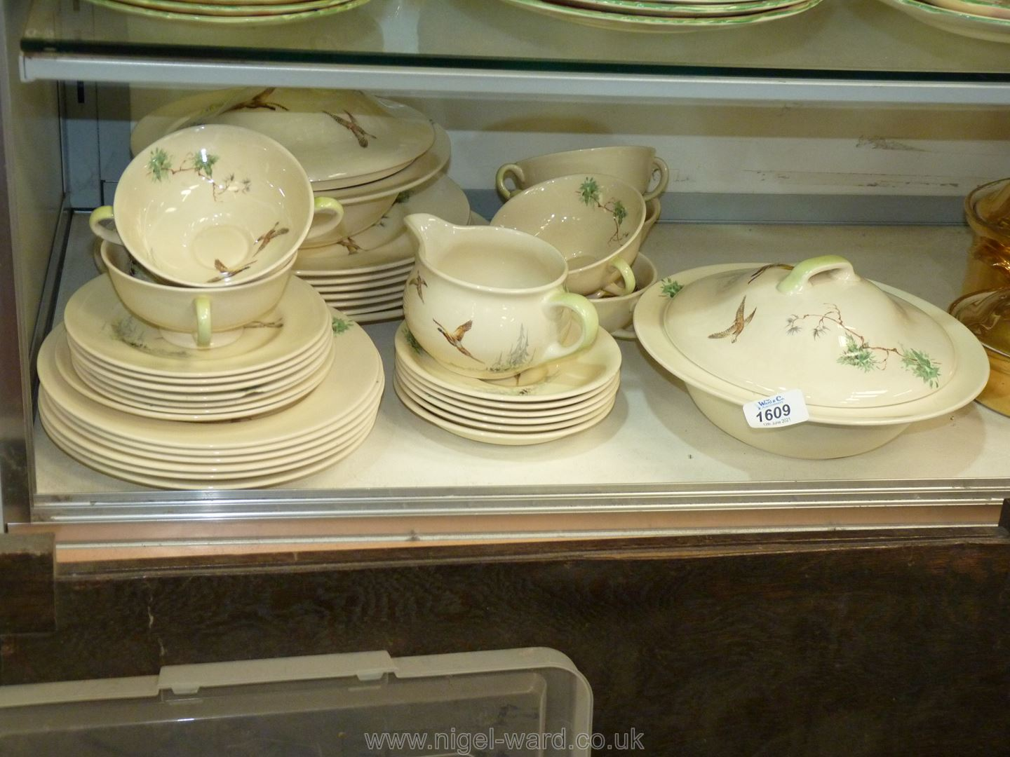 A Royal Doulton part dinner service 'The Coppice' including six two handled soup bowls and saucers,
