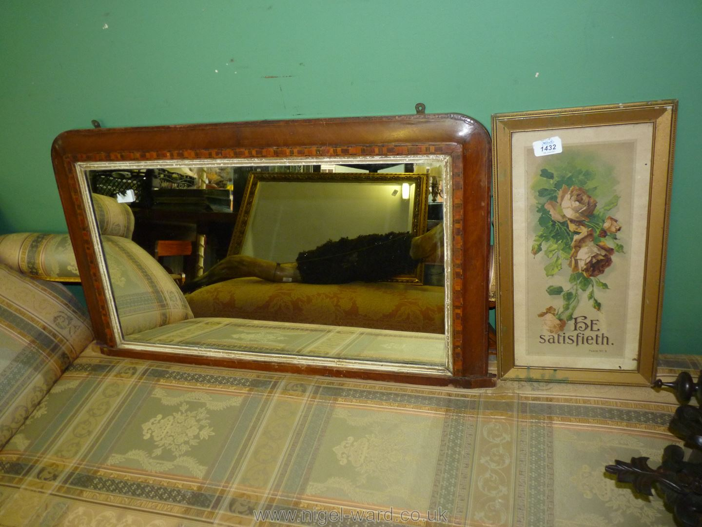 An Edwardian marquetry inlaid Mahogany over mantle mirror together with a similar Era Motto print.