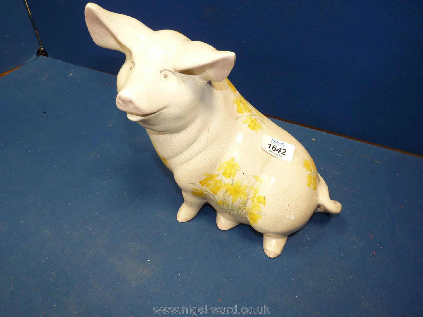 """A ceramic 'Happy Face' Pig, decorated with daffodils (crazing to glaze), 10 1/2"""" tall x 9"""" overall. - Image 2 of 3"""