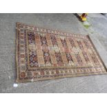 A multi-coloured, bordered, patterned and fringed Rug with geometric pattern to centre, 90'' x 55'',