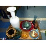 A quantity of coloured glass including large red bowl, three bud vases, orange perfume bottle etc.