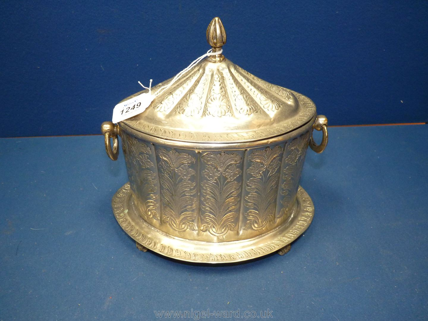 An Ottoman white metal tea caddy or box engraved with floral design,