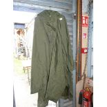 A large green waterproof hooded cape.