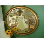 A large oval gilt framed Mirror,