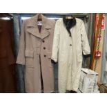 A ladies cream and black rainmac and cord overcoat by Teen Togs.
